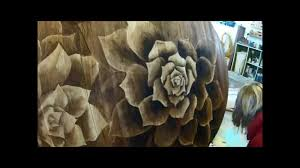 artwork with wood wood stain artwork on dining table succulents shading with