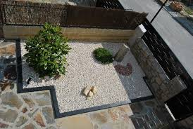 outdoors japanese rock garden with gravel and solid pathway