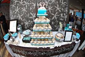 wedding reception dessert bar aqua and ivory cupcake tree rock