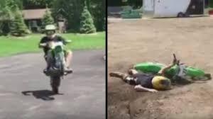 how to wheelie a motocross bike from dirt bike wheelie to a face full of dirt video break com