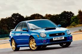 blue subaru gold rims our 5 favorite subaru wrx sti models automobile magazine