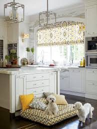window kitchen island and pendant lighting with roman shades also
