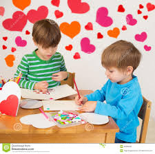 kids engaged in valentine u0027s day arts with hearts stock photo