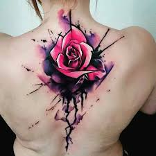 watercolor rose tattoo on upper back by uncl paul