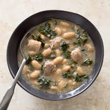 slow cooker pork and white bean stew with kale america u0027s test
