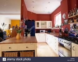 modern red kitchen range oven and peninsular unit in open plan modern red kitchen