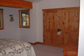 Pine Bifold Closet Doors White Finished Bifold Closet Door With White Trim Also Blue Wall