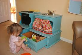 cool teal polished wooden toys cabinet with single drawer as