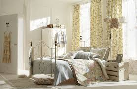 interior elegant shabby chic bedroom with rustic decorative bed