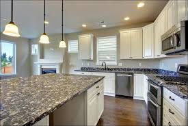 kitchen white cabinets black granite what color backsplash blue