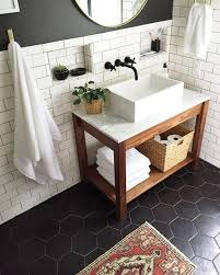 Floor Bathroom Cabinet by White Tiles On The Walls And Black Hexagon Tiles On The Floor For