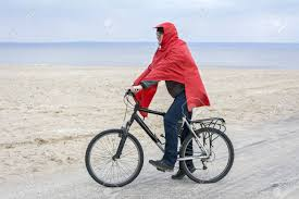 raincoat for bike riders handsome man on a bike ride in raincoat stock photo picture and