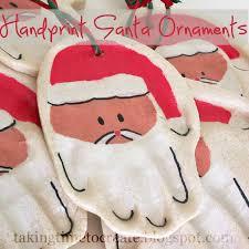 taking time to create handprint santa ornaments