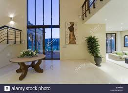 circular table and marble floor in large openplan hall with floor