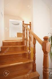 wooden stairs in house interior decoration wood and white walls