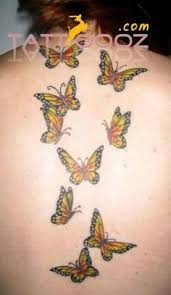 flying butterfly on back shoulder