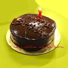 classic moist chocolate cake with glossy chocolate ganache frosting