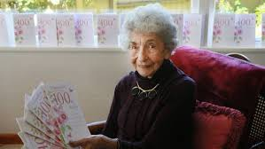 woman celebrating 100th birthday receives 50 double ups on cards