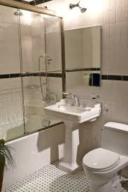white freestanding sink combined with white low bathtub with glass