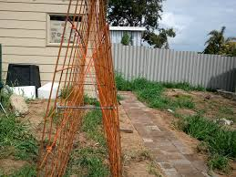 metal rods force the rebar sheets apart and electric wires diagonal ties prevent