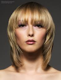 what is vertical layering haircut blonde medium length hairstyle with soft contours and transitions