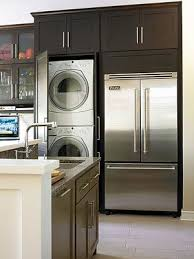 laundry in kitchen design ideas a washer and dryer are hidden within plain sight in this clever