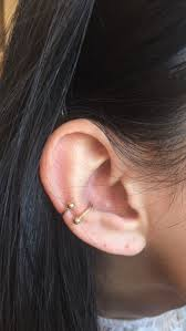 conch piercing cuff different types of ear piercings the complete list