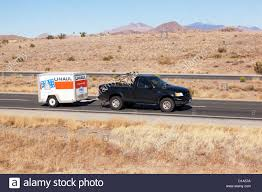pickup truck pulling u haul trailer arizona driver visible stock
