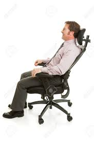 businessman relaxing in a comfortable ergonomic office chair