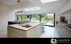 modern kitchen and large sliding doors u2013 transform architects