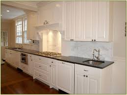 carrara marble backsplash carrera subway tile with white counters