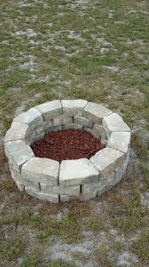shows how to build a cheap easy fire pit for your backyard all