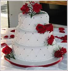 gorgeous decorated with red roses and white and red pearls wedding