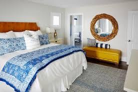 bedroom white bedroom blue blanket wooden headboard wooden floor