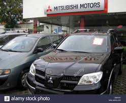 mitsubishi cars mitsubishi cars are parked on the premises of a mitsubishi car