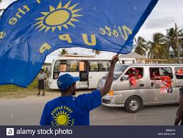 Flag Of Antigua A United Progressive Party Upp Supporter Waves His Flag At Antigua