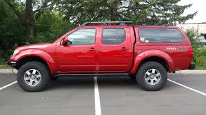 red nissan frontier lifted updated suspension lifts and body lifts for 2005 please read