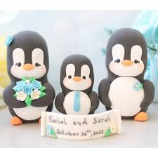 family cake toppers personalised penguin family wedding cake toppers with a kid