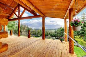 beautiful view of the log cabin house porch of green valley stock