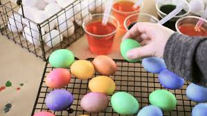 Decorate Easter Eggs Games by Easter Eggs Decorated In The Background Child Paint The Egg Stock