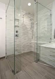 curbless shower with seat and handheld christine sheldon design