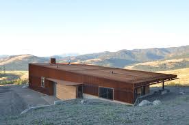 weathering steel glass cedar facade of cabin by johnston