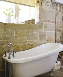 clawfoot tub bathroom design feng shui bathroom design ideas with stone wall accent and