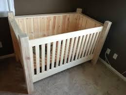 rustic nursery area using simple diy baby crib with wood material