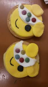 pudsey bear biscuits 1 ice some circle biscuits with icing sugar