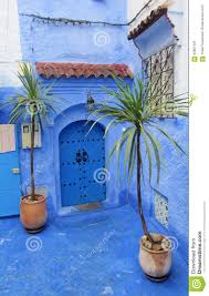Morocco Blue City by Blue Door In A Blue Wall In Chefchaouen Morocco Stock Photo