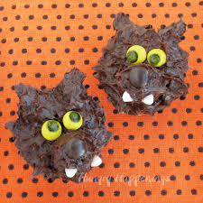 orange and black cookies and cream halloween magic bars hungry