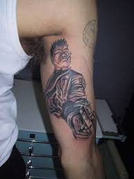 Tattoos On Biceps For - impressive with gun on biceps for boys picsmine