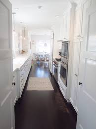 kitchen with white cabinets and dark floors kitchen crafters