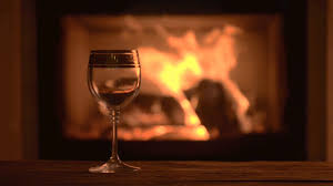 pouring delicious red wine at romantic fireplace stock video